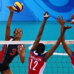 US player Tayyiba Haneef-Park (L) spikes the ball towards Cuban players Rosir Calderon (C) and Nancy Carrillo (R) during the women's volleyball semifinal in the 2008 Beijing Olympic Games in Beijing on August 21, 2008. AFP PHOTO / ALEXANDER JOE (Photo credit should read ALEXANDER JOE/AFP/Getty Images)